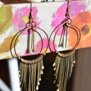 Golden tinted earrings, with fringe on bottom.